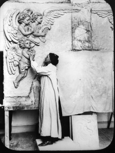 S. Rosamond Praeger working on the decoration of the façade of the Thomas Andrews/Titanic Memorial Hall.
